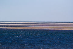 Sand bank. A series of sand banks in the sea Royalty Free Stock Image