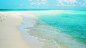 The sand bar appears at low tide on the island Lhaviyani, Maldives stock photography