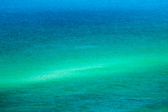 Sand Bar with Blue and Aqua Sea. Destin, FL USA - Sep 9, 2016  -  Looking dow at the beach the water changes from aqua to white to blue because of the sand bar Stock Photography