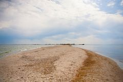Sand bar on sea coast in summer time Stock Photography