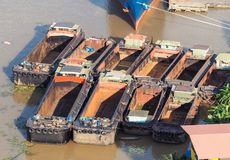 The sand barges floating in the river. The sand barges floating in the Chao Phraya River Park. Bangkok, Thailand royalty free stock photos