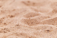 Sand on the beach as background with space for the text. Sea travel and holiday. Royalty Free Stock Photography