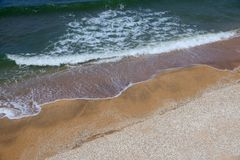 Sand beach background. Sand beach and water surface texture Stock Images
