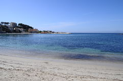 Sand beach in bandol, france. Blue sandy beach and sea in Renecros at Bandol village, France Royalty Free Stock Image