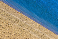 Sand beach and blue sea diagonal Royalty Free Stock Photo