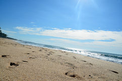 Sand beach and blue sky by the sea Stock Photo