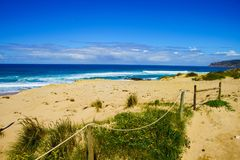 Sand beach and blue sky. Soft wave of blue ocean on sandy beach. Stock Images