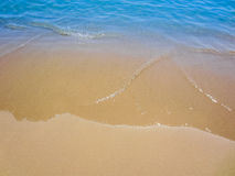Sand with beach and blue tropical sea Stock Photography