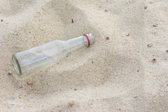 Sand beach with bottle texture background Royalty Free Stock Photos