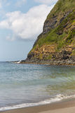 Sand beach and cliff in Agua de Pau, Azores. Portugal Stock Photography
