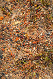 Sand beach with colorful stones background Royalty Free Stock Photos
