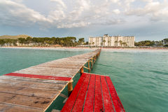 Sand beach deck chairs and pontoon Royalty Free Stock Photo
