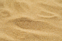 Sand of a beach or a desert or a sandpit. Closeup of a pile of sand of a beach or a desert or a sandpit Stock Image