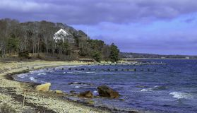 Sand Beach and a distance house in Cape Cod stock photo