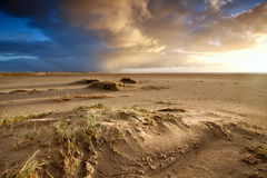 Sand beach and dramatic sky Royalty Free Stock Photo