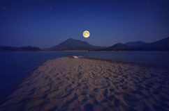 Sand beach in the evening moonlight Royalty Free Stock Photo