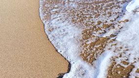 Sand beach and gentle,soft wave. Close up Royalty Free Stock Image