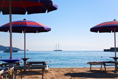 Sand beach in Giardini Naxos. (seaside town in Sicily) and view on Calabria mountains on horizon Stock Photos