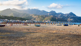Sand beach in Giardini Naxos town in evening Royalty Free Stock Images