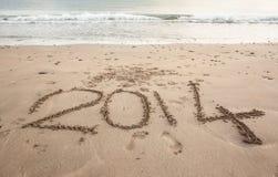 2014 on sand at beach Stock Photos