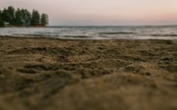 The sand on the beach of lake. Sand on the shore of Lake Sugoyak at sunset Stock Images
