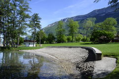 Sand beach and lawn on Annecy lake Royalty Free Stock Photography