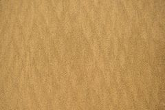 Sand of a beach with line pattern. Empty background stock images