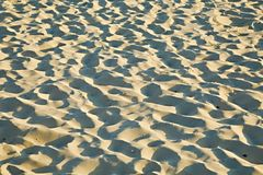 Sand of a beach Stock Images