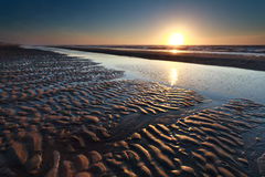 Sand beach at low tide and sunset Royalty Free Stock Photography