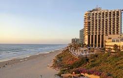 Sand beach and modern hotels in Herzliya Pituah, Israel. HERZLIYA, ISRAEL - AUGUST 25, 2015: Sand beach and modern hotels in Herzliya Pituah, Israel. Sunset Stock Photo