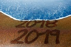 2018 2019 sand beach New Year is coming Royalty Free Stock Images