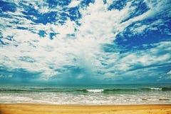 Sand beach, ocean and cloudy sky Royalty Free Stock Photos