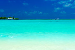 Sand beach and ocean vessels, Maldives Royalty Free Stock Photography