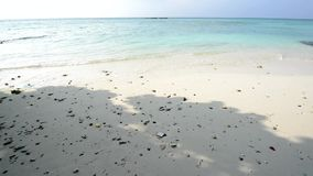 Sand beach and ocean wave, South Male Atoll stock video