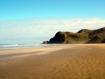 Sand Beach with pacific ocean waves on North Island in New Zealand Stock Image