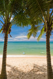 Sand beach with pams and canoes in Phu Quoc. Close to Duong Dong, Vietnam Stock Photography
