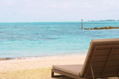 Sand beach with parasol and Sunbeds. Caribbean tropical sand beach with parasol and Sunbeds Stock Images