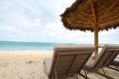 Sand beach with parasol and Sunbeds. Caribbean tropical sand beach with parasol and Sunbeds Stock Photo