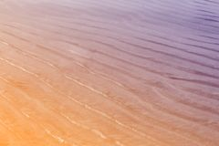Sand on the beach pastel color filter. Beautiful waves on sand, nature abstract background royalty free stock photos