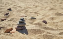 Sand on the beach, pebble stones stock photography