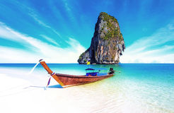 Sand beach on sea coast of tropical island in Thailand Royalty Free Stock Photography
