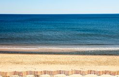 Sand Beach with Sea Oats and Dune Fence Panoramic royalty free stock photography