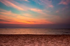 Sand beach sea on twilight sky cloud background, sun set time. Copy space stock photo