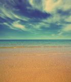 Sand beach and sea - vintage retro style Royalty Free Stock Images