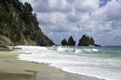 Sand Beach, Sky, Rocks and Ocean. Beautiful New Zealand. Coromandel. Summer time Stock Photo