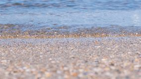 Sand beach with small waves. Beautiful seascape. Sand beach with small waves. Beautiful seascape royalty free stock photo
