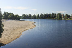 Sand beach of spa in the town of Mirgorod on Khorol River early. In the morning in Ukraine stock image