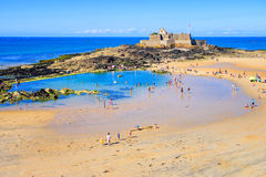 Sand beach in St Malo on Emerald Coast, Brittany, France Stock Images