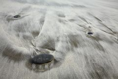 Sand beach with stones Stock Photo
