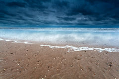 Sand beach at storm on North sea Stock Photography